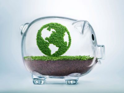 Green Earth inside a glass piggybank