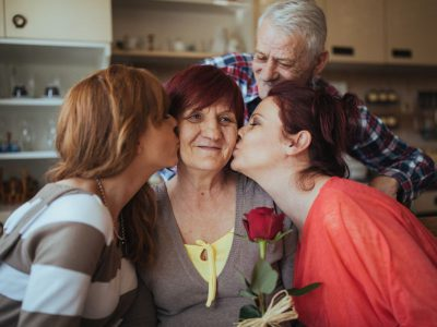 Daughters give Mom a rose