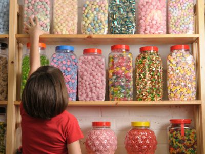 Kid reaching for candy jar
