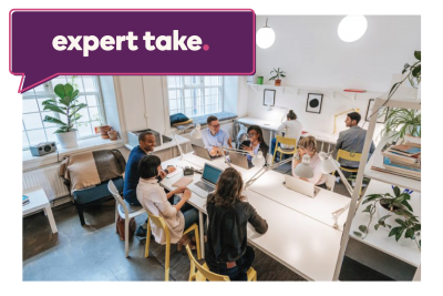 "Discussion in an open office setting with ""Expert Take"" text written"