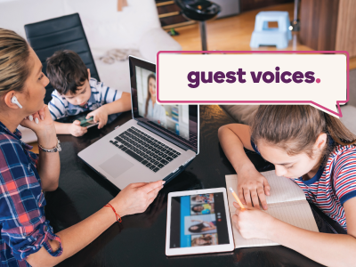 Guest Voices banner over a woman working on her laptop while her kids study and play around her