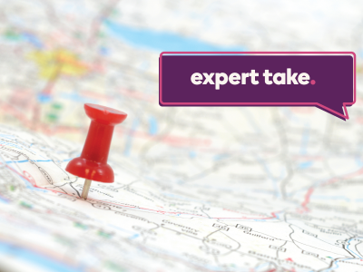 "Image shows a map with a big red pin in it. Tag reads: ""Expert Take"""