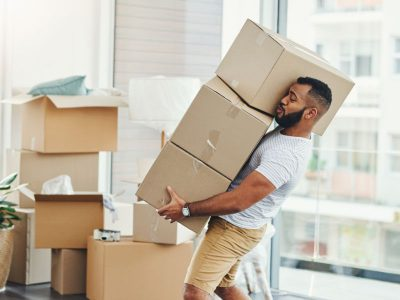 Man tries to carry too many moving boxes