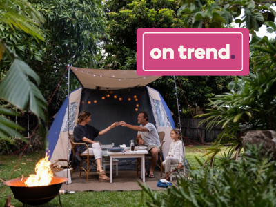 """On Trend"" banner over image of family camping in a tent in their backyard"