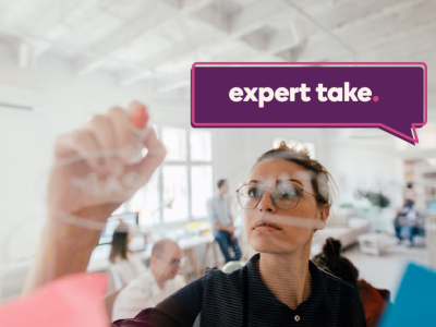 """Expert Take"" bubble over an image of a woman works on equation on a window"