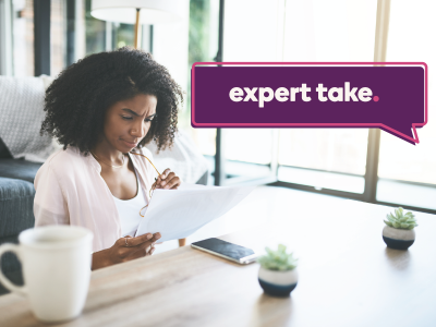 Expert Take banner of an image of a woman contemplating some papers