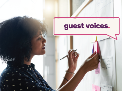 Guest Voices banner over image of woman brainstorming on a white board