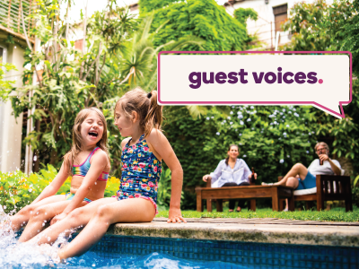 Guest Voices banner over image of two little girls laughing and splashing by the pool