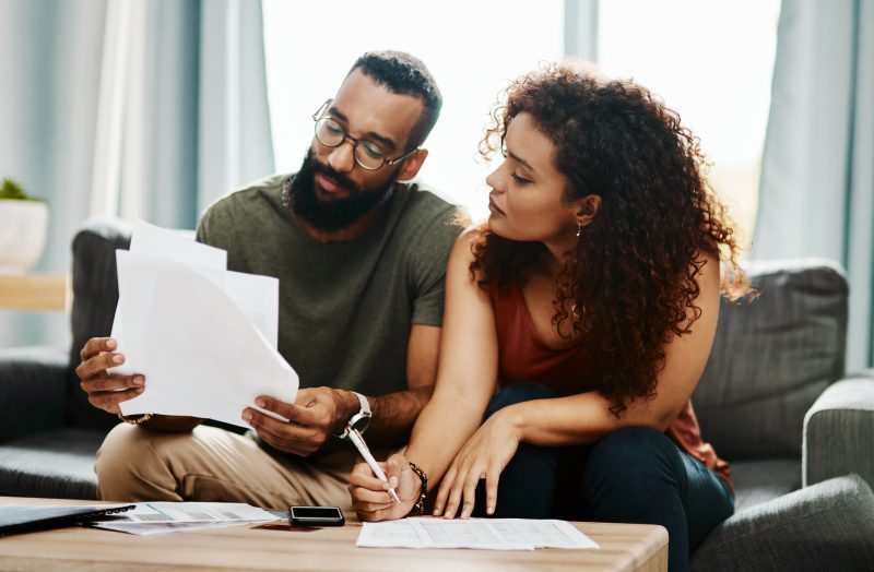 Couple looks over their finances together